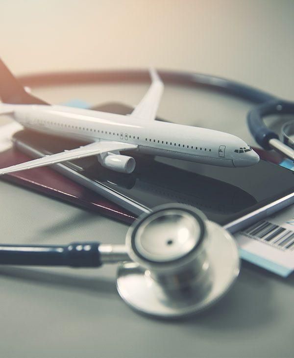 tiny airplane, stethoscope, and passport